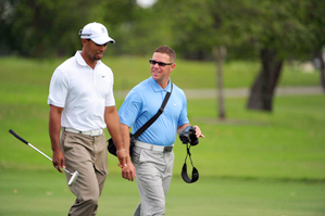 Tiger Woods and swing coach Sean Foley Wednesday at Doral.