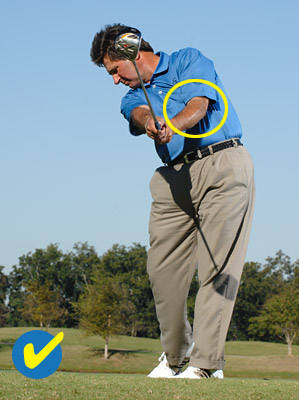 For correct extension and a square clubface at impact, rotate and bend your left elbow so that it points down in your release.