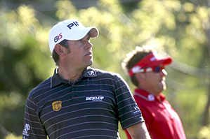 Lee Westwood, left, lost to Ian Poulter on Saturday morning.