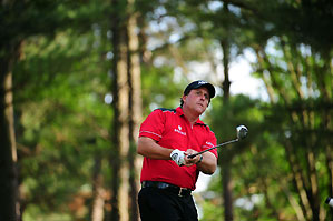 Phil Mickelson was near the lead until making double bogeys on Nos. 15 and 18.