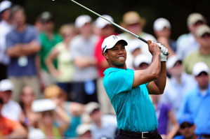 Tiger Woods made the cut on Friday at the Players, a week after his poor performance at Quail Hollow.