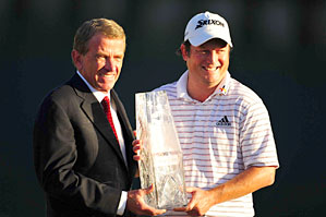 Tim Clark, right, with PGA Tour commissioner Tim Finchem, finally got his first PGA Tour win on Sunday.