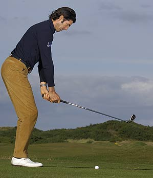 If you're tense or out-of-sync hinge the club up with your wrists.