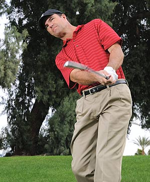 Hold the clubface open through impact to curve it out of trouble.