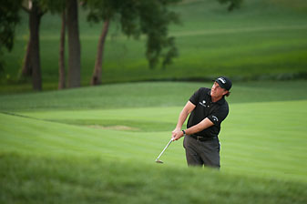 Phil Mickelson almost holed this pitch shot for birdie on the 16th hole Sunday but ended up making bogey and lost the PGA Championship by one shot to Rory McIlroy.