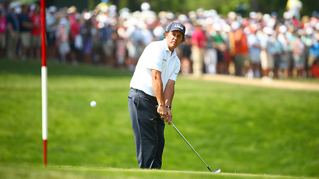 Phil Mickelson shot an even-par 70 to take a one-shot lead into Sunday's final round.