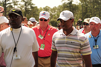 Johnny Miller, center, following Tiger Woods at the 2010 Masters.
