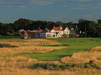 The par 4, 18th hole and the clubhouse behind the green at the Honourable Company of Edinburgh Golfers at Muirfield in Gullane, Scotland.
