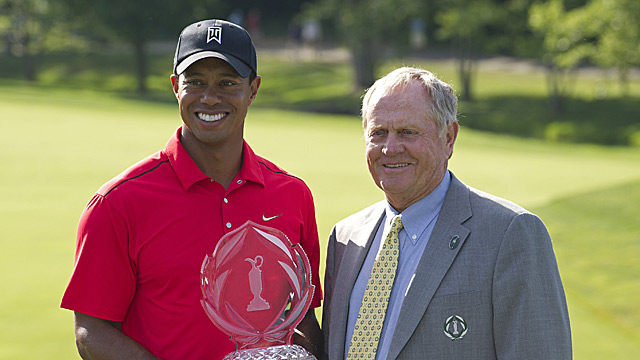 Tiger Woods and Jack Nicklaus pose for photos after Woods' victory at the 2012 Memorial Tournament.