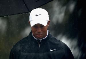 Tiger Woods shot an even-par 71 in heavy rain on Saturday.