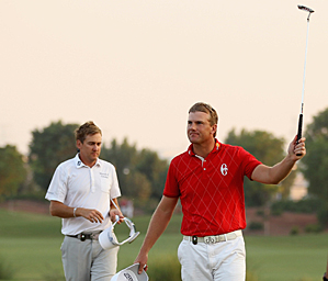 Robert Karlsson, right, made birdie on the second playoff hole to beat Ian Poulter.