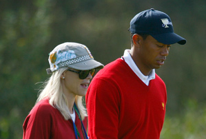 Police found Tiger Woods lying on the ground with his wife, Elin, hovering over him after a car accident early Friday morning.