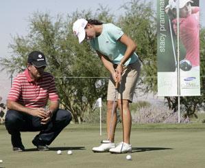 Lorena Ochoa worked on her putting Wednesday with her coach Rafael Alarcon.