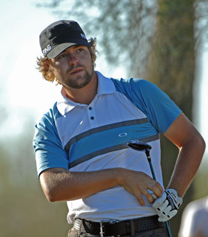 Ryan Moore shot a seven-under 63 to grab a three-shot lead.
