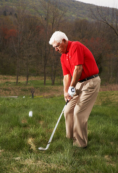 <strong>How to Pitch From Deep Rough</strong><br />                  <i>Take practice swings to feel how to knife through the grass</i>                 <p>By David Glenz<br />                 Top 100 Teacher                 </p><p>                 This story is for you if...                 </p><p>                 • You think you have to chop the ball out when pitching from rough.                 <br />                 • Your pitch swing is an arms-only swing.                 </p><p>                 <strong>The Situation</strong>                 <br />                 Your ball has landed in thick rough (you can barely see the top of it) 20 yards short of the green. To save par, you have to dig it out and land it close. That's a tall order.                 </p><p>                 <strong>The Solution</strong>                 <br />                 Because the ball is deep in the grass, you think you have to chop it out with your arms, but that's a sure recipe for inconsistent contact. The key is to turn your body with your swing. Practice this move from a similar lie until you're confident in your ability to cut through the grass. It's very similar to a bunker shot in that you want to get the club through the grass and underneath the ball.                 </p>