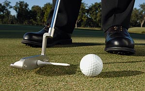 To get this move down pat, attach a tee to your putter as shown (double-sided tape works well) and stroke putts at home or in the office. You'll notice improvement in your stroke in a week.