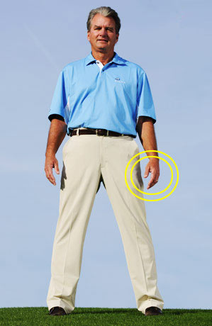At this stance width (exactly three inches narrower than the one pictured at right), my arms hang exactly the same. My weight is balanced between the balls and arches of both feet, placing me in position to swing the club on plane.