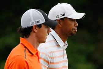 Tiger Woods and Rory McIlroy on the 10th hole at Merion on Friday. Woods and McIlroy will play together Saturday after they both finished 36 holes at 3-over.