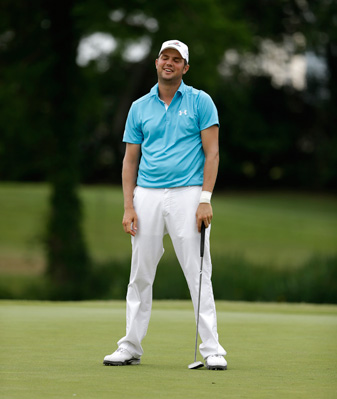 Jeff Overton was disqualified for using a putting aid on a practice green while waiting to play the back nine Saturday at Colonial.