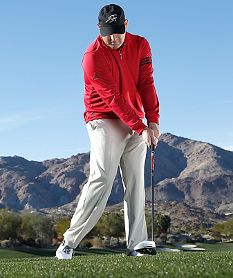 Once you reach the impact zone, keep moving your right side through the ball so the clubhead can't flip past your hands.