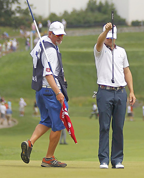 When he's not playing on the Senior tour, Damon Green caddies for Zach Johnson.