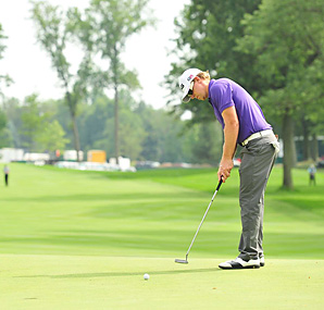 Hunter Mahan's touch on downhill putts helped lock up his second PGA Tour win of the season.