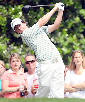 Rory McIlroy set a course record with a 10-under 62 for a four-shot victory over Phil Mickelson.