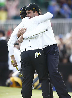 Francesco and Edoardo Molinari stole a half point from the U.S. with a halve against Stewart Cink and Matt Kuchar.