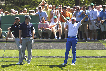 Ian Poulter (right) had fun on the 16th hole with fellow Europeans Graeme McDowell and Justin Rose.
