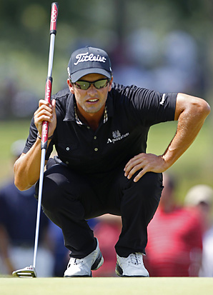 Adam Scott shot a bogey-free 65 for his eighth career victory.