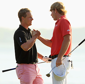 Brandt Snedeker (right) beat Luke Donald in sudden death and denied the Englishman the No. 1 ranking.