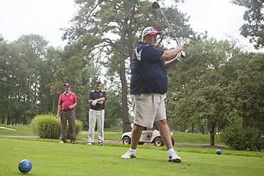 George Siller tees off at Glenwood Country Club in Old Bridge, N.J., on Aug. 21, 2011, as his brothers Russ, far left, and Frank look on. The Siller brothers were supposed to play on Sept. 11, 2001, with their brother Stephen, who died at the World Trade Center that day.