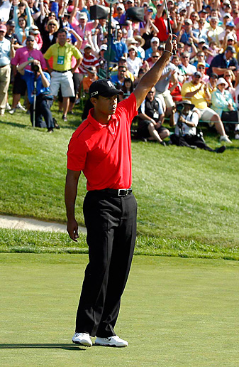 Tiger Woods shot a 67 to erase a four-shot deficit to earn his second victory of the year.