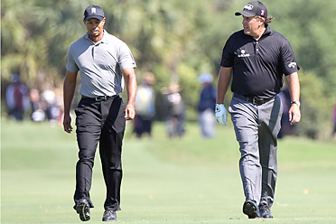Tiger Woods and Phil Mickelson are tied for 34th place at Doral and will play together again on Saturday.