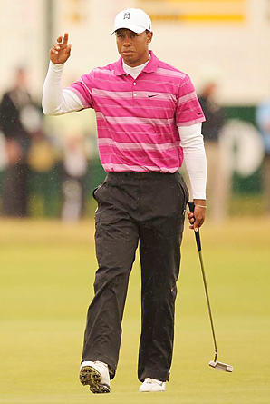 Tiger Woods began his quest for a third British Open title at St. Andrews with an opening 67.
