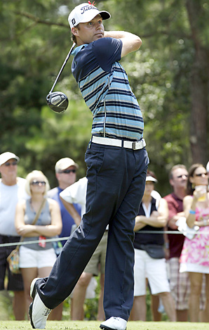 Nick Watney shot a 64 and missed tying Greg Norman's course record by one stroke.
