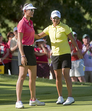 Michelle Wie (left) finsihed one shot behind Yani Tseng after Tseng fired a 65 on Sunday.