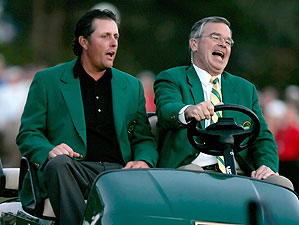 Phil Mickelson wears the winner's green jacket as he gets a ride in a golf cart driven by Billy Payne after winning the 2006 Masters.