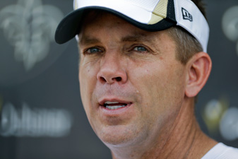 New Orleans Saints head coach Sean Payton is caddying for Ryan Palmer this week at the Greenbrier
