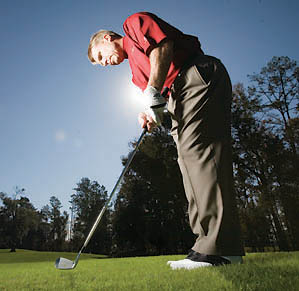 Get the toe of the club up and the handle forward for a solid, consistent chipping stroke.