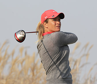 Suzann Pettersen shot a course-record 63 to take the lead.