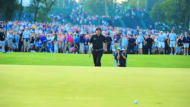 Crowds gather on the 18th fairway behind Phil Mickelson to watch his third shot on Sunday.