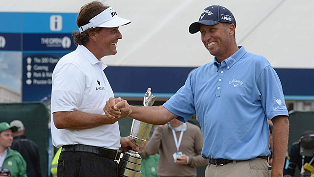 """Mickelson celebrates his victory with longtime caddie and friend Jim """"Bones"""" Mackay."""