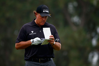 Phil Mickelson checks his yardage book during the first round of the 2014 U.S. Open on Thursday.