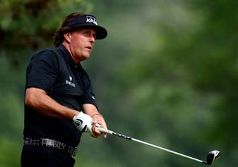 Phil Mickelson watches his tee shot on the second hole during the final round of the 2013 U.S. Open at Merion Golf Club.