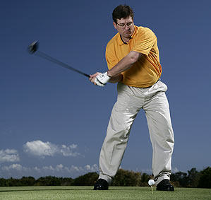 Your lower body leads your arms down into position. If you start your swing with your hands and arms, you can't get into this powerful position.