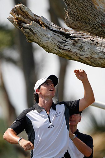 Rory McIlroy's tee shot lodged in tree on the third hole Saturday, but he still saved par.