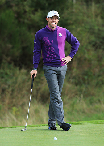 Rory McIlroy smiles after a putt during practice ahead of the 2014 Ryder Cup.