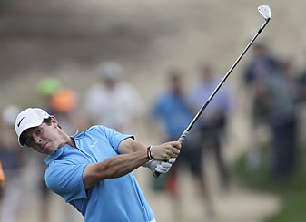 Rory McIlroy plays a ball on the 12th hole during the third round of the Dubai Desert Classic. McIlroy trails Stephen Gallacher who shot a back-nine 28 on his way to 63 on Saturday.