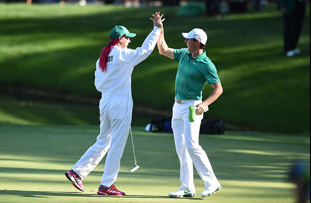 Rory McIlroy celebrates with caddie and fiancee Caroline Wozniacki during Wednesday's Par-3 Contest, where he displayed a jauntiness and humor that had gone missing from his game in 2013.